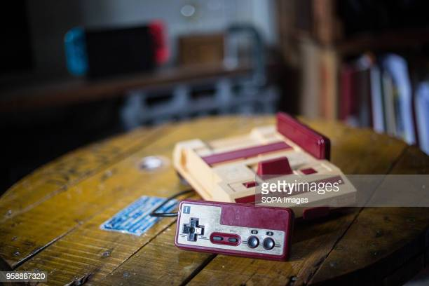 In this photo illustration, an old vintage Japanese market version of the Nintendo 'Family Computer' video game console knows also as 'Famicom'. The...