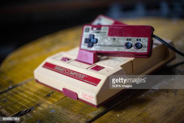 An old vintage Japanese market version of the Nintendo 'Family Computer' video game console knows also as 'Famicom' The Famicom cames out in 1983 and...