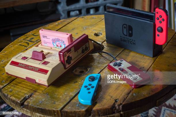In this photo illustration an old vintage Japanese market version of the Nintendo 'Family Computer' video game console knows also as 'Famicom'...