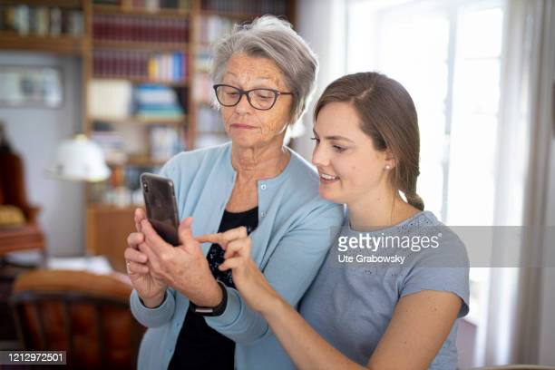 In this photo illustration an old woman is using a smartphone on May 12 2020 in Radevormwald Germany