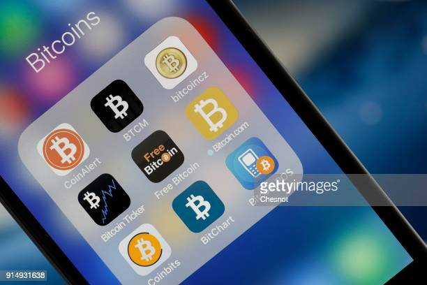 In this photo illustration applications for Bitcoins are seen on the screen of an Iphone on February 6 2018 in Paris France The cryptocurrency market...