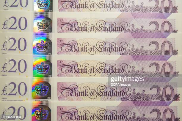 In this photo illustration banknotes of the pound sterling The Bank of England £20 notes are seen displayed