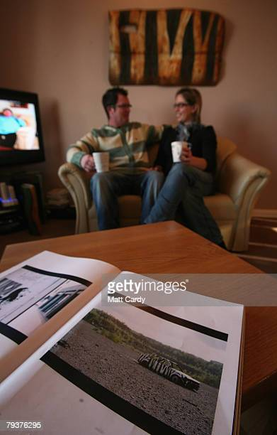 In this photo illustration Banksy's book Wall and Piece lies open on a table as John Chalmers and Emma Smele drink a cup of tea beneath a door on...