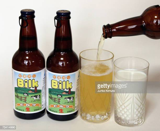 In this photo illustration Bilk a beer made from milk is poured into a glass next to a glass of milk on February 25 2007 in Tokyo Japan A liquor shop...