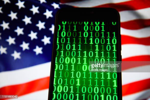 In this photo illustration binary code seen displayed on a smartphone