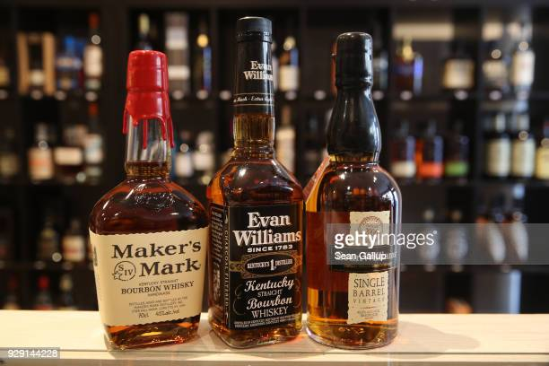 In this photo illustration bottles of American bourbon whiskey stand arranged at a whiskey shop on March 8 2018 in Berlin Germany US President Donald...