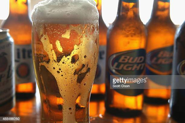 In this photo illustration bottles of Miller Lite and Bud Light beer that are products of SABMiller and AnheuserBusch InBev are shown on September 15...
