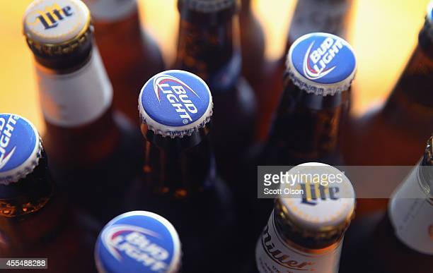 In this photo illustration, bottles of Miller Lite and Bud Light beer that are products of SABMiller and Anheuser-Busch InBev are shown on September...