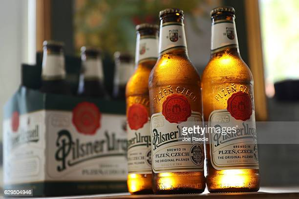 In this photo illustration bottles of Pilsner Urquell from the Czech Republica are seen on December 13 2016 in Miami Florida Japanese brewer Asahi...