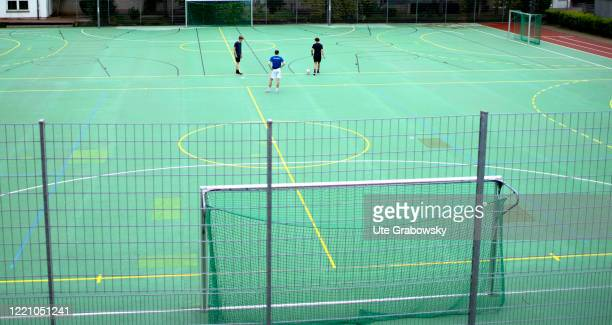In this photo illustration boys are playing football on a playground on June 11 2020 in Bonn Germany