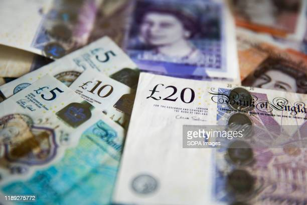 In this photo illustration, British Pound currency bank notes seen displayed.