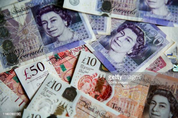 In this photo illustration British Pound sterling banknotes are seen as Pound to US Dollar exchange rates are now trading close to a 2 ½ year low...