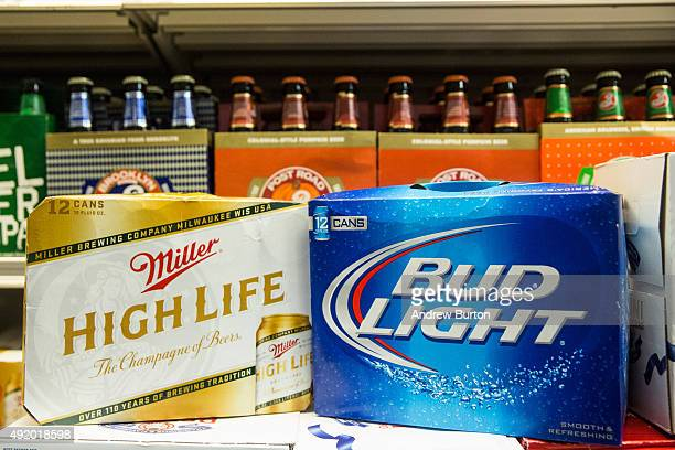 In this photo illustration, Bud Light beer and Miller High Life beer are sold in a grocery store on October 9, 2015 in New York City. Budweiser's...