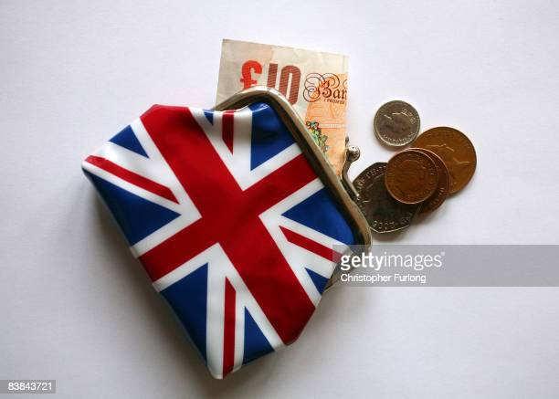 In this photo illustration cash is pictured with a purse November 27 2008 in Manchester England With the Christmas shopping season upon us many UK...