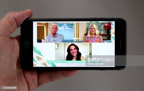 In this photo illustration Catherine Duchess of Cambridge is being interviewed by ITV's This Morning about the launch of Hold Still on May 07 2020 in...