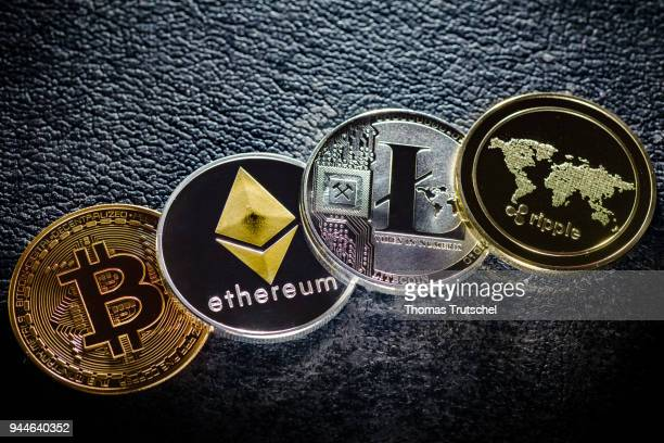 In this photo illustration coins of the crypto currencies bitcoin ethereum litecoin and ripple stands on a hard disk on April 10 2018 in Berlin...