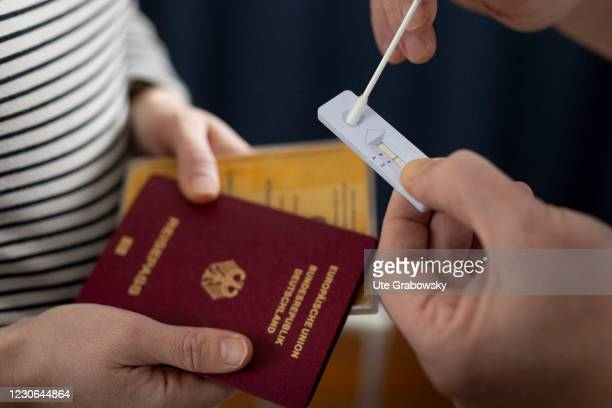 In this photo illustration Corona test, passport and vaccination certificate on January 17, 2021 in Bonn, Germany.