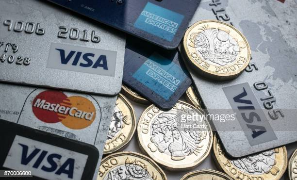 In this photo illustration credit and debit cards are seen alongside pound coins on November 3 2017 in Bristol England The Bank of England raised...