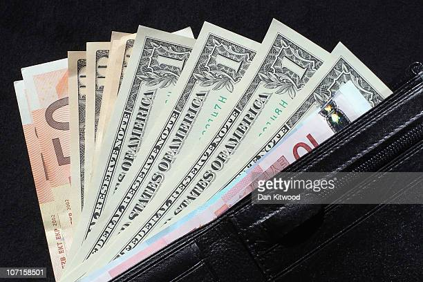 In this photo illustration Dollar and Euro notes are displayed in a wallet on November 26 2010 in London England Concerns over the Euro zone debts...