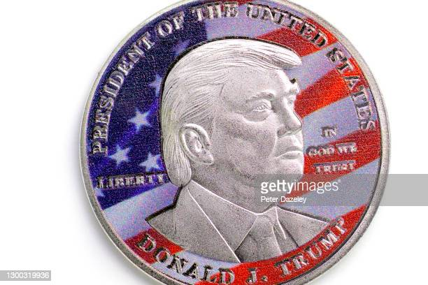In this photo illustration, Donald J Trump is pictured on the side of coin on February 4,2021 in London, England.