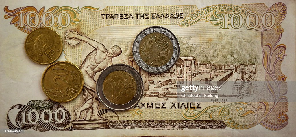In this photo illustration Euro coins lay on a 1000 Drachma note, the currency in Greece before the Euro, on July 8, 2015 in Athens, Greece. Eurozone leaders have offered the Greek government one more chance to propose a viable solution of it's debt or face the possibilty a likely exit from the euro.