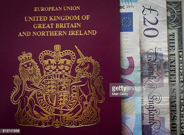 In this photo illustration Euro Dollar and pound sterling notes are seen inside a UK passport on October 10 2016 in Bath England Since the UK voted...