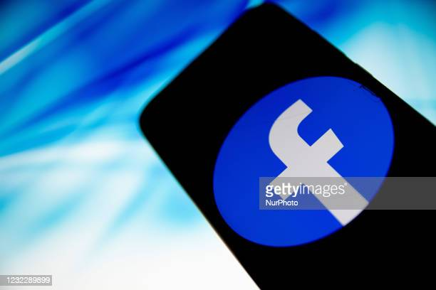 In this photo illustration Facebook logo is displayed on a smartphone screen in Athens, Greece on April 13, 2021