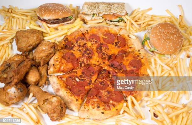 In this photo illustration fast food from a branch of McDonald's Burger King KFC Subway and Domino's pizza is pictured on February 20 2018 in Bristol...