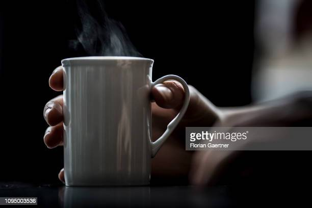 In this photo illustration female hands are pictured with a steaming cup of tea on February 05, 2019 in Berlin, Germany.