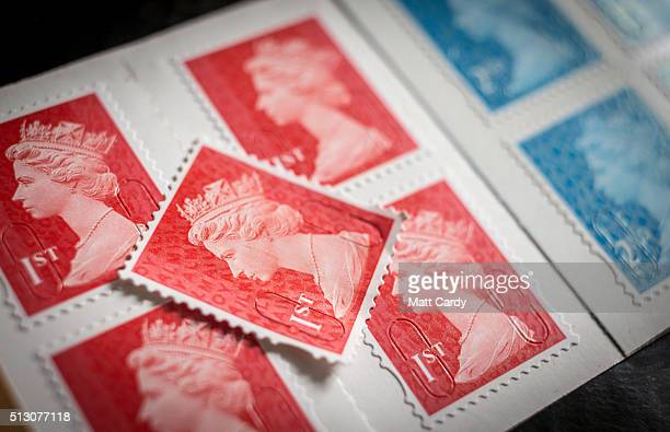 In this photo illustration first and second class postage stamps are displayed on February 29 2016 in Bath England Royal Mail recently privatised is...
