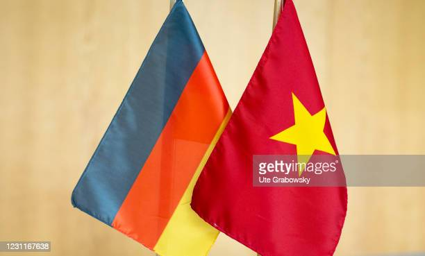 In this photo illustration flags symbolize the friendship of the countries on February 08, 2021 in Bonn, Germany.
