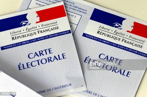 In this photo illustration French voter registration cards for the 2017 French presidential elections are seen on April 20 2017 in Paris France...