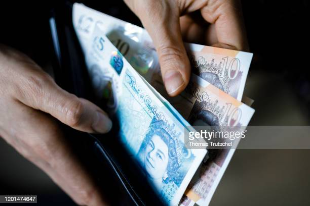 In this photo illustration GBP banknotes are counted in a wallet on February 17 2020 in Berlin Germany
