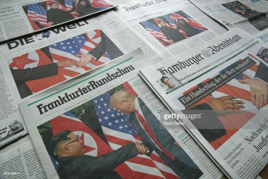 In this photo illustration German newspaper front pages from June 13 lie arranged and all show U.S. President Donald Trump meeting North Korean leader Kim Jong-un on June 13, 2018 in Berlin, Germany. The historic meeting between the two leaders yesterday in Singapore is the dominating news topic today in Germany.