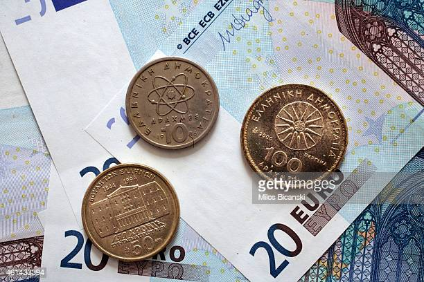 In this photo Illustration Greek Greek Drahama coins sit on paper money of twenty Euros bills on January 12 2015 in Athens Greece Global markets have...
