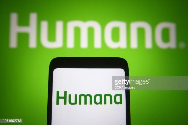 In this photo illustration, Humana logo is seen displayed on a smartphone and a pc screen.