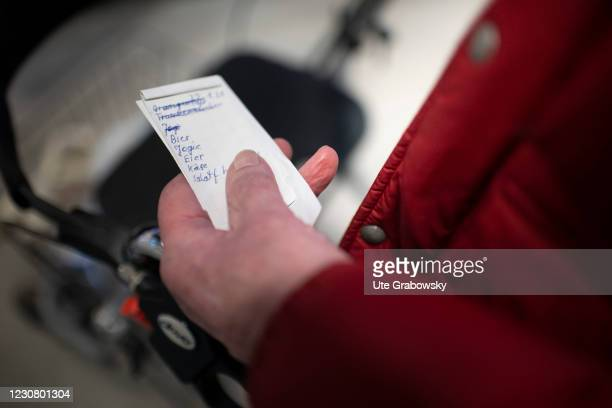 In this photo illustration is a shopping list in old hands on January 23, 2021 in Heidelberg, Germany.