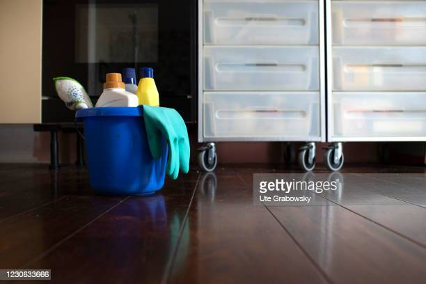 In this photo illustration is cleaning bucket with cleaning products on a floor of a kitchenon January 14, 2021 in Bonn, Germany.