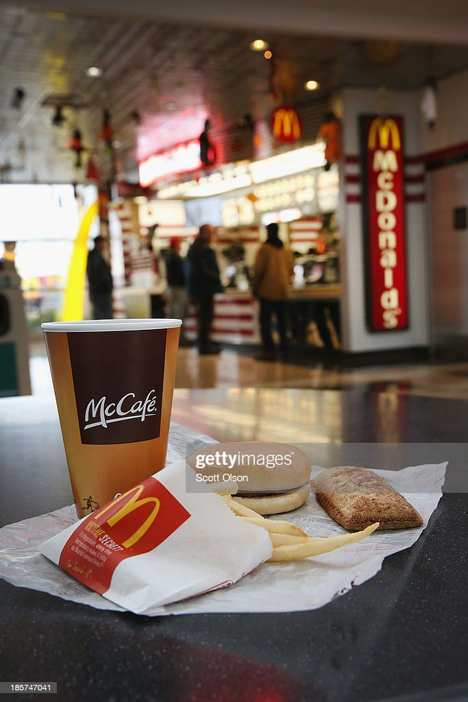In this photo illustration, items are shown from a McDonald's restaurant on October 24, 2013 in Des Plaines, Illinois. McDonald's has announced it will make changes to its low-priced Dollar Menu, which includes items like coffee, small fries, hamburgers and apple pies. The new menu, dubbed the Dollar Menu and More, will offer some higher priced options such as the grilled Onion Cheddar Burger and a McChicken sandwich.