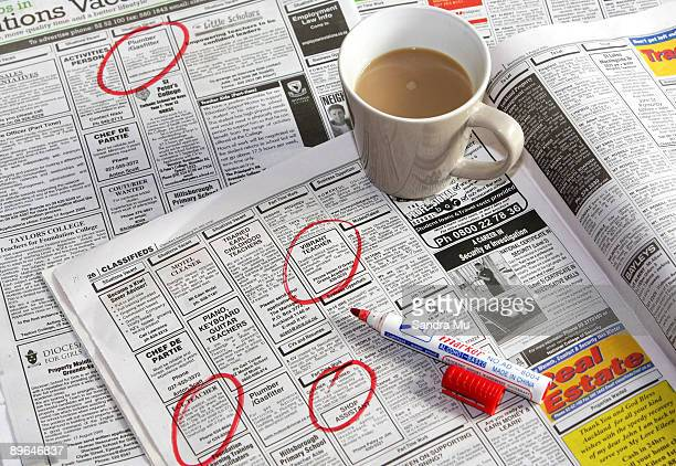 In this photo illustration job vacancies are displayed in the newspaper on August 7 2009 in Auckland New Zealand New Zealand's unempoyment rate which...