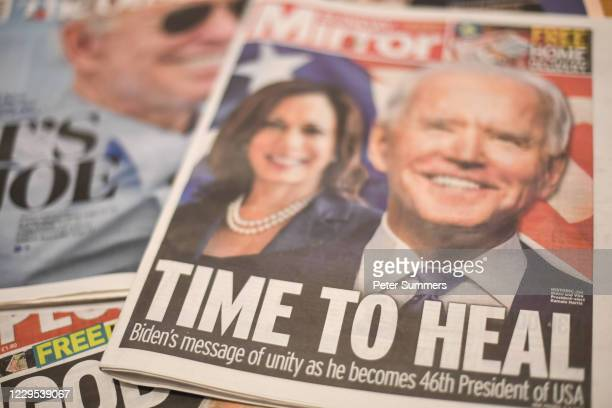 In this photo illustration, Joe Biden's projected US presidential election victory is seen on the front pages of British newspapers on November 8,...