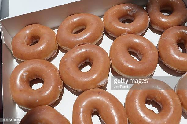 In this photo illustration, Krispy Kreme Donuts are seen on May 09, 2016 in Miami, Florida. JAB Holdings Company, announced it is acquiring Krispy...