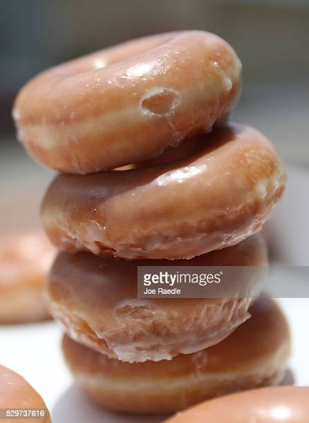 In this photo illustration Krispy Kreme Donuts are seen on May 09 2016 in Miami Florida JAB Holdings Company announced it is acquiring Krispy Kreme...