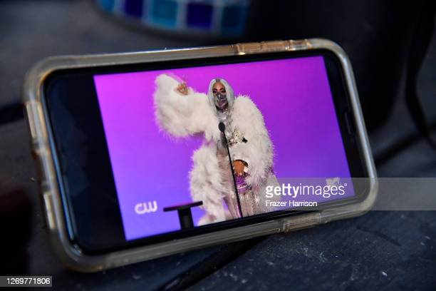 In this photo illustration Lady Gaga accepts the Artist of the Year award viewed on a mobile device during the 2020 MTV Video Music Awards broadcast...