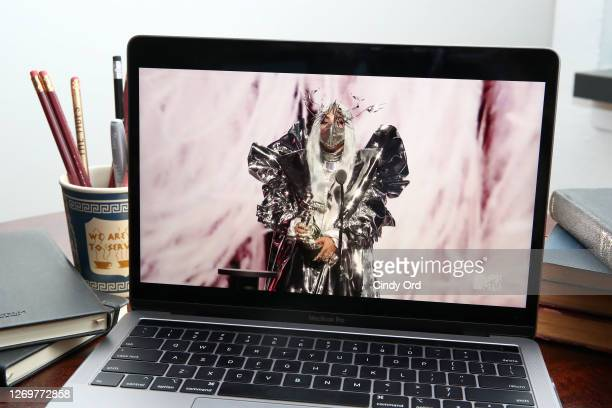 In this photo illustration Lady Gaga accepts the MTV Tricon Award viewed on a laptop during the 2020 MTV Video Music Awards broadcast on August 30...