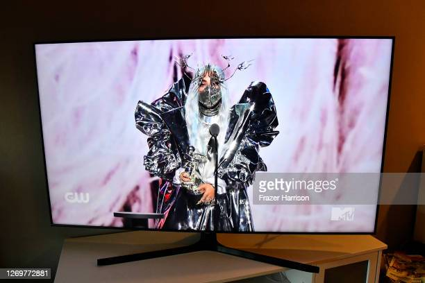 In this photo illustration Lady Gaga accepts the MTV Tricon Award viewed on a television screen during the 2020 MTV Video Music Awards broadcast on...