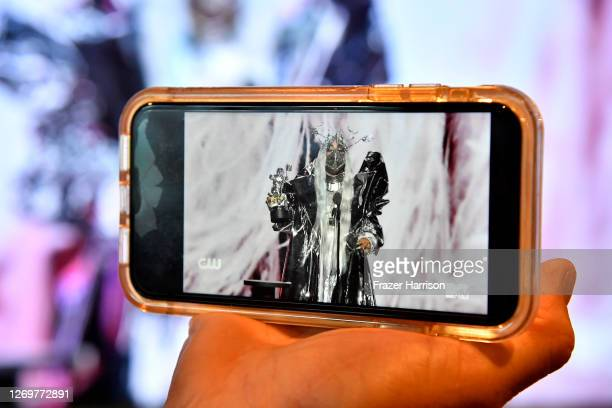 In this photo illustration Lady Gaga accepts the MTV Tricon Award viewed on a mobile device during the 2020 MTV Video Music Awards broadcast on...