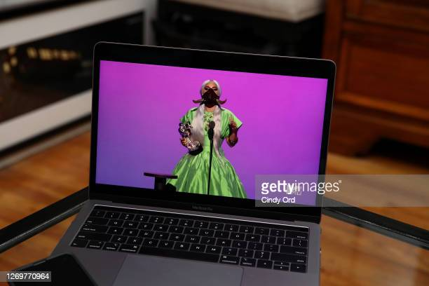 In this photo illustration Lady Gaga accepts the Song of the Year award for Rain on Me viewed on a laptop performs during the 2020 MTV Video Music...