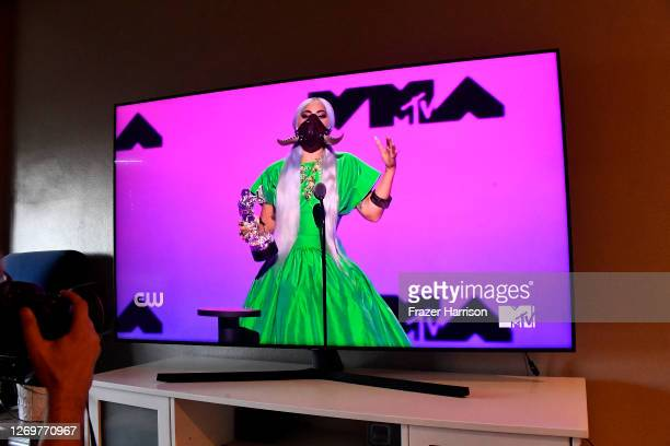 In this photo illustration Lady Gaga accepts the Song of the Year award for Rain on Me viewed on a television screen performs during the 2020 MTV...