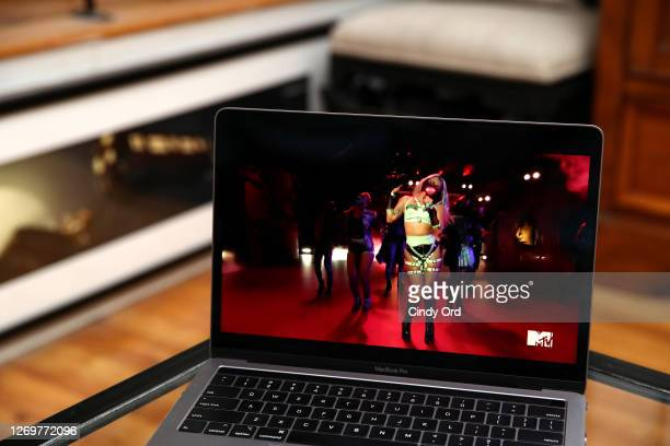 In this photo illustration Lady Gaga viewed on a laptop performs during the 2020 MTV Video Music Awards broadcast on August 30 2020 in New York City